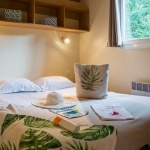 Lit double chalet Montana - Camping Bela Basque****