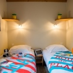 Lits simples chalet Montana - Camping Bela Basque****